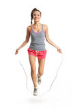 Energetic woman jumping rope Stock Images