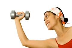 Energetic woman lifting weights at fitness stock image
