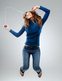 Energetic woman with music player royalty free stock image