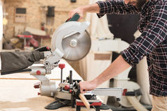 Energetic woodworker is toiling with pleasure Stock Image