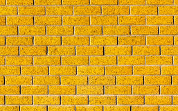 Energetic yellow brick wall as a background image with black vig Stock Images