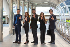 Energetic Young Businesspeople, three businessmen and two Busine Stock Images