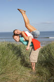 Energetic Young Couple Having Fun In Dunes. By Beach Royalty Free Stock Images