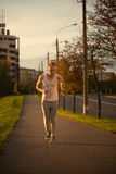 Energetic young man do exercises outdoors in park to keep their Royalty Free Stock Images