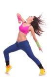 Energetic young woman dancer stock image