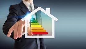 Energetica domestica - uomo di affari Immagini Stock Libere da Diritti