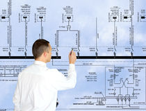 Energetics business. Professional engineer designer admiring size generate electric fundamental scheme Royalty Free Stock Photo
