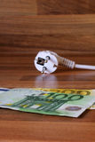 Energia e dinheiro Fotos de Stock