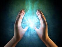 Energia proveniente dalle mani Fotografie Stock