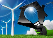 Energias eólicas - casa com uma ampola Imagem de Stock Royalty Free