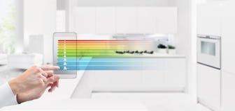 Energie - besparing en slimme van het de controleconcept van de huisautomatisering de handtou royalty-vrije stock foto's