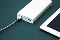 Energiebank und -laptop Stockfotografie