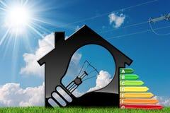 Energieeffizienz - vorbildliches House mit Glühlampe stock abbildung