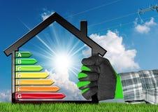 Energieffektivitet - symbol med husmodellen Royaltyfria Foton