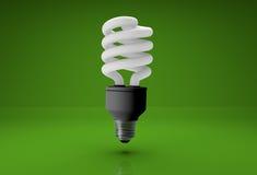 energiesparende Birne 3d auf grünem Hintergrund Lizenzfreies Stockfoto