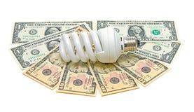 Energiesparende Glühlampe und Banknoten Lizenzfreie Stockfotos