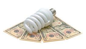 Energiesparende Glühlampe und US-Dollar Lizenzfreie Stockbilder