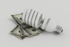 Energiesparende Glühlampe, Abwehrenergie und Geld Stockbild