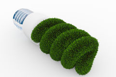 Energiesparende Lampe hergestellt vom grünen Gras Stockbilder