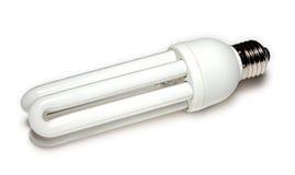 Energiesparende Lampe am Weiß Stockfotografie