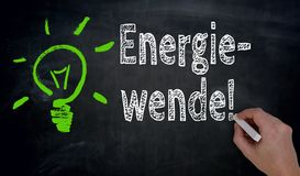 Energiewende in german green Energy is written by hand on blac Royalty Free Stock Photos