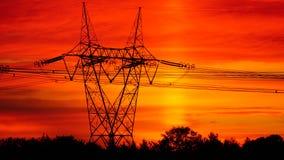 Energistolpar i soluppgång Fotografering för Bildbyråer