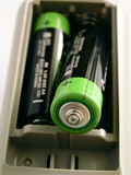 Energize it!. Loading batteries into a remote control. Focus in front. Brand markings not visible royalty free stock images