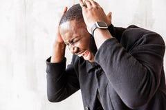 Energized african stylish man listening to vigorous music Royalty Free Stock Image