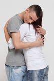 Energizing hug. Young men emraces a girl Stock Photography