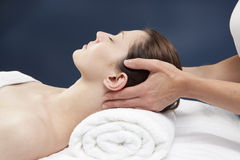 Energizing neck massage. Well-being and calmness from the spa Stock Photos