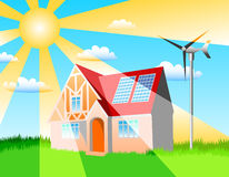 Energy. A house with solar panels and wind turbine Royalty Free Stock Photography