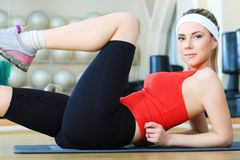 Energy. Young sporty woman in the gym centre stock photos