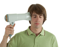 Energy. Young man with a hair dryer royalty free stock photo