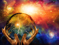 Energy. Observed in sphere held in hands Royalty Free Stock Photo