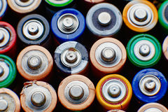 Energy abstract background of colorful batteries. Stock Photos