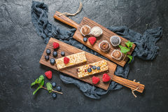 Energy bars and balls. Snack for healthy lifestyle on black background, top view royalty free stock photo