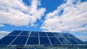 Several solar panels work on the roof, close up. Enviroment friendly energy concept. Energy batteries collect light to generate heat stock footage