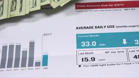 Electric bill statement - energy expense and finance concept stock footage