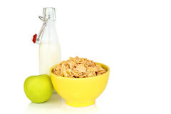 Energy breakfast for diet cereal flakes of corn milk and green apple isolated on white background. With copy space stock photography