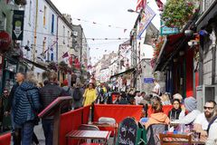 Energy and bustle of Galway, Ireland. Due to the city of Galway`s rich cultural and historical heritage, tourists flock to its cafes, pubs, shops, and royalty free stock photo