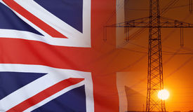 Energy Concept Great Britain Flag with sunset power pole. Concept Energy Distribution, Flag of Great Britain with high voltage power pole during sunset Stock Photo
