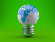 Energy concept. Light bulb with planet earth. Energy concept, light bulb with planet earth on a green background Stock Photos