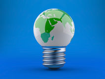 Energy concept. Light bulb with planet earth. Energy concept, light bulb with planet earth on a blue background Royalty Free Stock Image