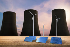 Energy concept with solar cells, wind turbines and nuclear react Stock Image