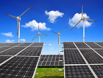Energy concept. Solar energy panels and wind turbines Royalty Free Stock Photos