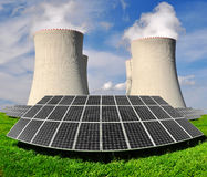 Energy concepts. Solar energy panels before a nuclear power plant Royalty Free Stock Images