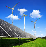 Energy concepts. Solar energy panels and wind turbines Stock Photography