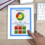 Energy consumption application on digital tablet. Using of energy consumption application for home show on digital tablet display royalty free stock photos