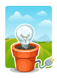 Energy consumption concept. Light bulb in flower pot Stock Images