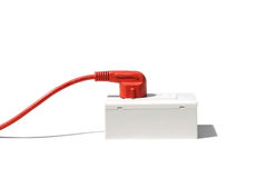 Energy consumption. Red plug in a socket / Energy consumption concept royalty free stock photos